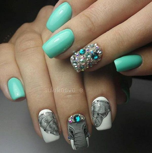 Manicure where the image extends to three or four nails is very fashionable and popular.