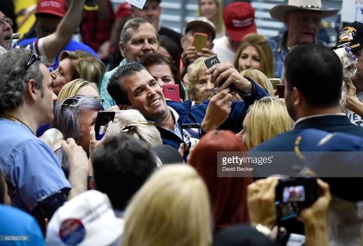 Donald Trump Jr. takes a selfie with supporters at a get-out-the-vote rally for his father, Republican presidential nominee Donald Trump, at Ahern Manufacturing on November 3, 2016 in Las Vegas, Nevada. Trump Jr. urged people to vote for his father during early voting, which ends on November 4 in the battleground state, and on Election Day November 8.