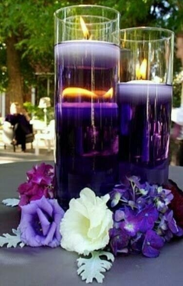 Centre piece idea; food colouring in the water and floating candles