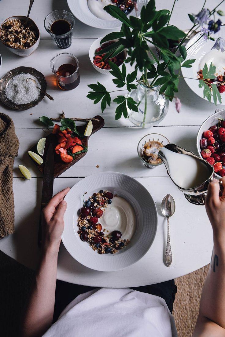 Homemade gluten-free vegan granola with fruits and coconut yogurt for breakfast.