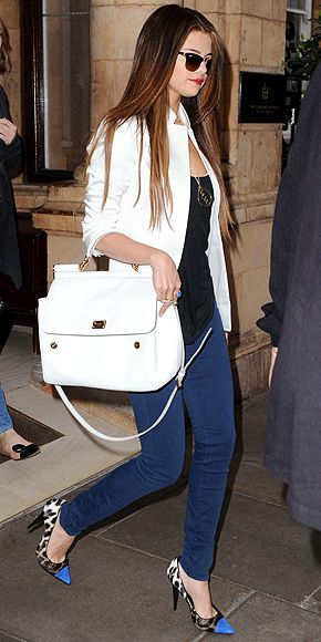 Selena Gomez in jeans, a white blazer, blue cap-toe leopard pumps, a statement necklace and an oversize Dolce & Gabanna handbag