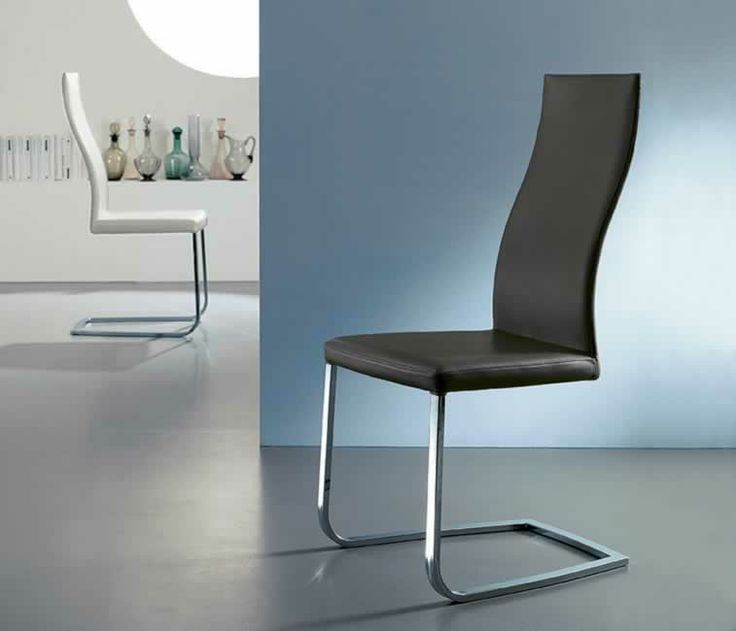 SOUL, design: Studio Ozeta Sled pedestalmetal frame chair with soft leather covering. www.ozzio.com