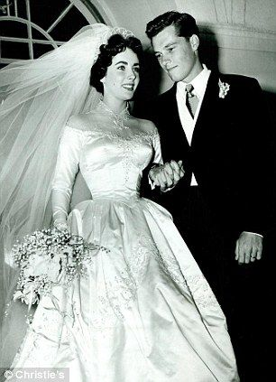 Elizabeth Taylor's first wedding dress sold for £120,000 ($184,362) on June 26, 2013.  A fierce bidding war at Christie's auction house in London saw the dress, which Elizabeth Taylor was given by MGM after she starred in 'Father of the Bride' in 1950, sell for more than twice the highest estimate. #elizabethtaylor #weddingdress #mgm