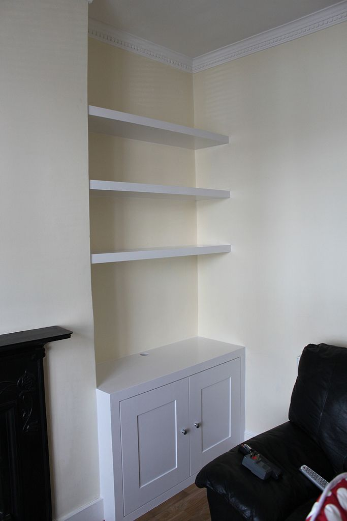 http://www.jvcarpentry.com/photos/Fitted-Bookcases-Bes/cupboard_floating_shelves_uk.JPG