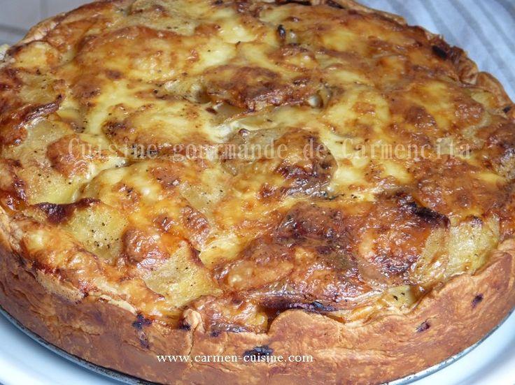 Préparation : 20 min Cuisson : 45 min Ingrédients Pour 8 personnes 1 pâte feuilletée 1 kg de pommes de terre 15 tranches fines de bacon 200 g de lardons allumettes fumés 1 oignon 3 œufs entiers 20 cl de crème fraîche 20 cl de lait 15 à 20 tranches de...