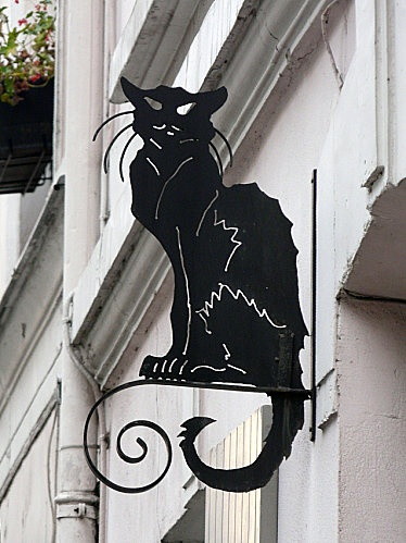 12th arrondissement - wrought iron sign of a cat outside one of the houses on rue Cremieux.