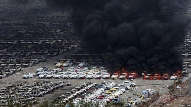 Damaged vehicles burning near blast site - 15 August