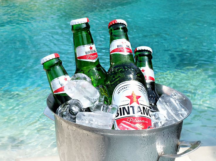 """Don't miss our """"Beer by the Bucket"""" available daily at #TheTAOBali and #CelepookPoolBar. Choose from our range of beers such us Bali Hai, Bintang, and Heineken to spruce up your days!   #thetanjungbenoabeachresortbali #thetanjungbenoa #TheTaoBali #bali"""