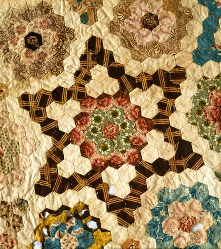 Mosaic Star - quilt maker lived 1776 to 1856, married 1795; fabric primarily early 19th century chintz and good example of 1825 period.