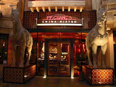 PF Changs - multiple locations for this chain - offers a gluten free menu and the bar staff is well-versed in GF cocktails!