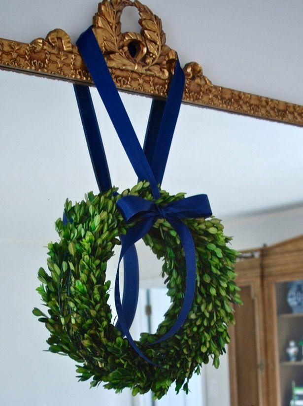 Learn how to make these elegant boxwood wreaths with this preserved boxwood wreath tutorial. It is an easy DIY great for holiday decor.