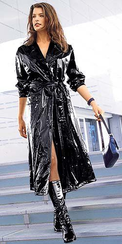 Get me Rain! Black vinyl raincoat worn as it should be with confidence and little else underneath.
