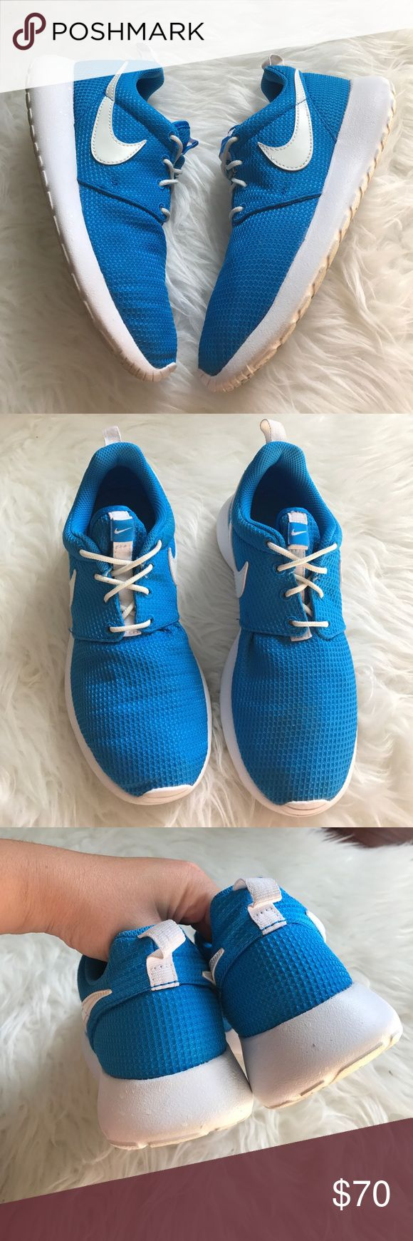 Nike Blue Glow In The Dark Roshe Sneakers Excellent used condition. Only worn a few times. Wear is only on the soles. Labeled size 4Y which is equivalent to a women's size 5.5. Last picture shows what they look like in the dark. Nike Shoes Sneakers