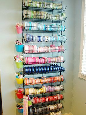 Hang tiny colorful buckets to the side of storage units with metal clips. Valerie's pails hold favorite ribbon scraps and fabric samples