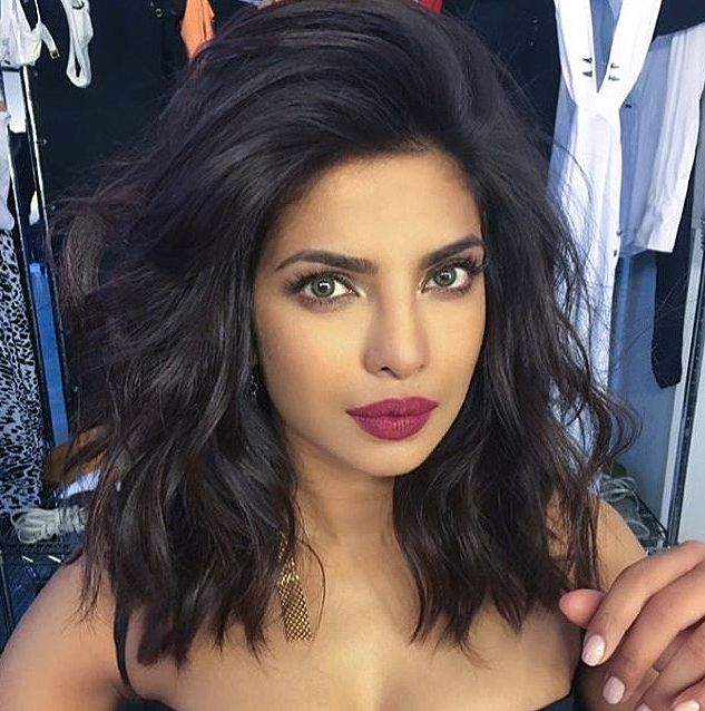"""PRIYANKA CHOPRA The Look: Side-Swept Waves The Breakdown: """"I know it seems counterintuitive to apply mousse to hair before you blow it out, but it controls frizz and makes hair moldable, which is so important when you have shorter hair,"""" says hairstylist Harry Josh. He then blows her hair up and over to one side (focusing on the roots) using a round brush and a blow dryer, before creating waves with a 1-in. curling iron."""