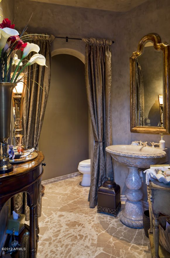 Mediterranean Powder Room with carved marble pedestal lavatory...
