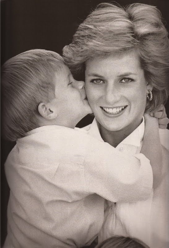 Butterfly kisses! Adorable shot of a young Prince Harry kissing his mum, Princess Diana