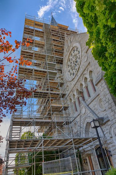 Scaffolding around steeple at St. Michael the Archangel Roman Catholic Church in Belleville, Ontario. HDR efx balanced.