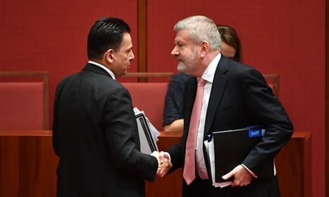 Nick Xenophon congratulates minister for communications Mitch Fifield after passing the media ownership bill in the Senate.