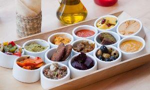 Oferta: Marokańskie przysmaki: tajin oraz mix przystawek z pieczywem lafa dla 2 osób za 49 zł i więcej w Marrakesh Cafe, w Warszawa. Cena: 49zł