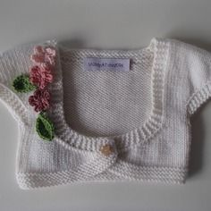 Scaldacuore da bebè in merino bianca con fiori tonalità rosa