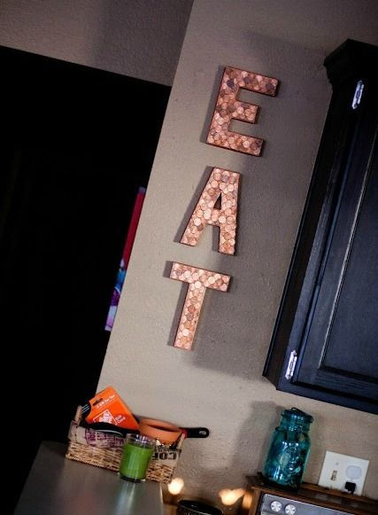 Maybe on the wall between patio door and cabinets... Some word or phrase. DIY Penny Kitchen Wall Decor - The Best Penny Projects and Coin Crafts