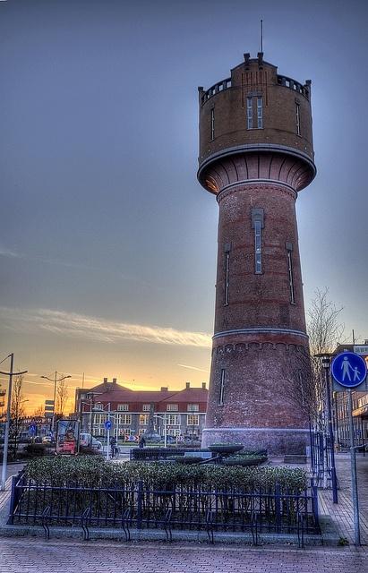 Den Helder; Watertower rises above the sunset by klaash63, via Flickr