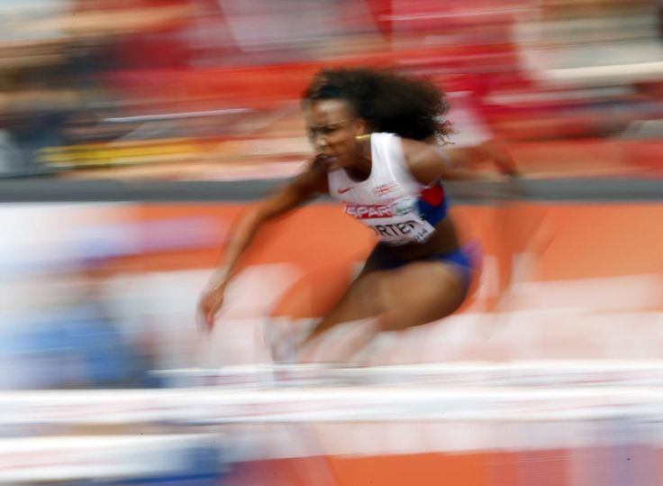 Tiffany Porter of Britain competes in the women's 100 metres hurdles heat during the European Athletics Championships at the Letzigrund Stadium in Zurich August 12, 2014.