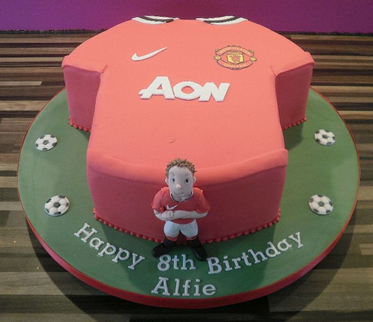 Football shirt cake with model of boy.