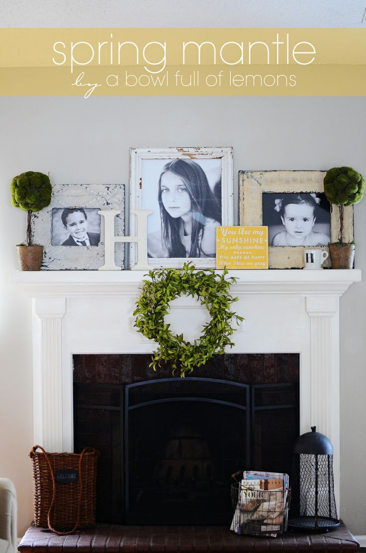 Spring Mantel with great layers and topiaries - via A Bowl Full of Lemons