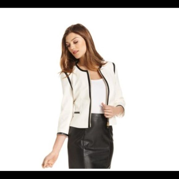 ✨Calvin Klein white skirt suit Beautiful Calvin Klein skirt suit. Jacket size 12/skirt size 8. Great condition. Only worn twice.  Freshly dry cleaned. Faux leather detail. No stains or imperfections. #calvinklein Calvin Klein Dresses