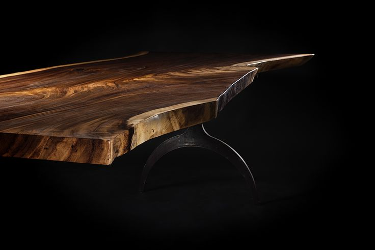 Live edge table with steel base by OSTROLUCKY