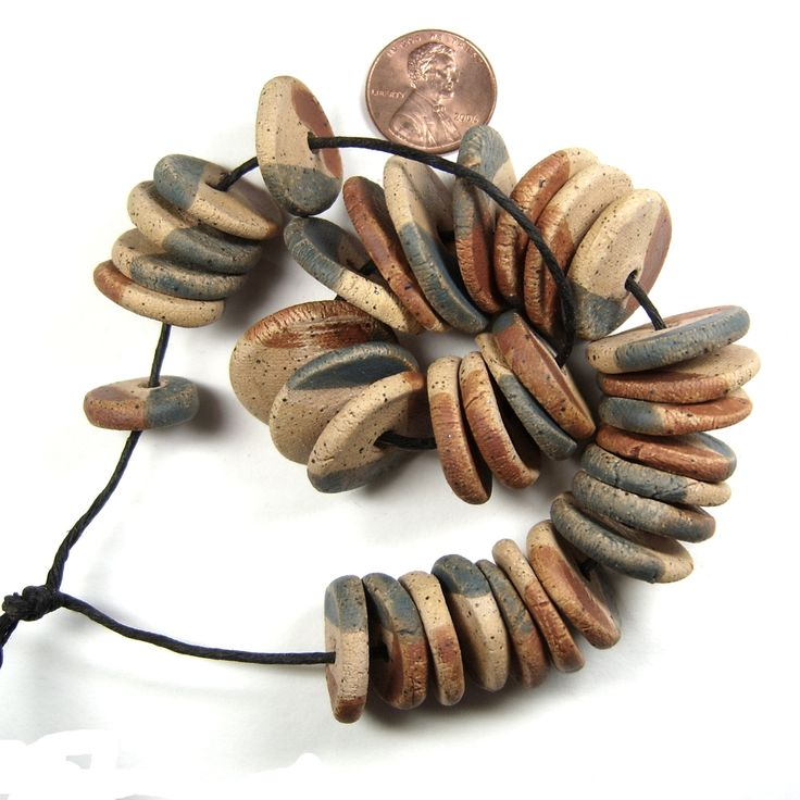 ABS August Bead strand stoneware discs finished with terra sigillata by BHClaysmith.