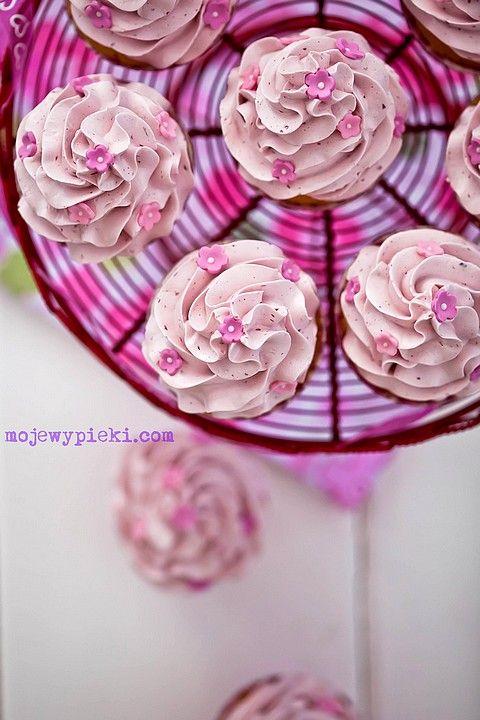 Raspberry cupcakes with raspberry swiss meringue buttercream.