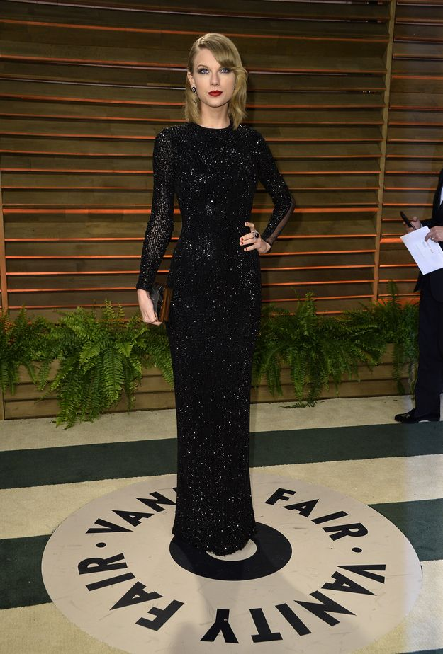Taylor Swift in a Julien Macdonald dress, Emm Kuo clutch, Tamara Mellon shoes, and Lorraine Schwartz jewelry. | 57 Awesome 2014 Oscars After-Party Dresses The Stars Partied In Last Night