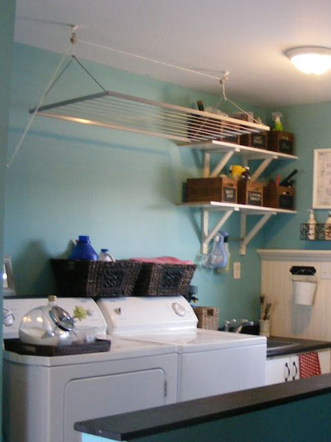Utilize the space over the washer/dryer for the drying rack. Genuis!!!