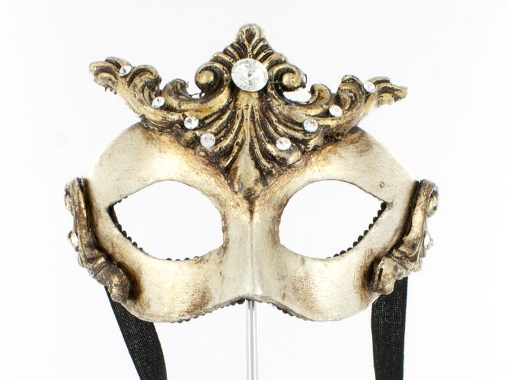 http://www.miofidelio.com/sito/en__p__102__small_baroque.html Small Baroque It's a smaller but not less valuable version of the Baroque.  This is also an aged gold mask that can no doubt be considered an art object, which in turn takes the soul of its wearer.  The masks are designed for mio Fidelio as unique pieces, handcrafted in Venice.. They are decorated with compositions that are different one from the other, so each creation is original.