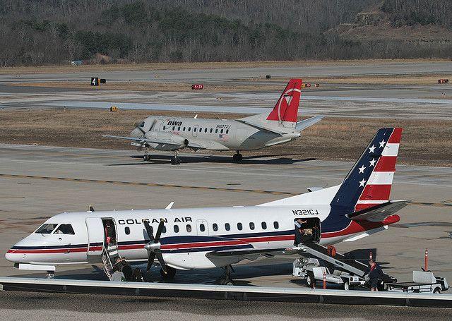 COLGAN AIR SAAB 340B N321CJ, and NWA (Mesaba) SAAB 340B N407XJ  at CRW, Yeager Airport, Kanawha County, Charleston, West Virginia, USA. Dec 2008