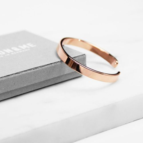 This is the perfect wedding ring, plain and simple; because, who needs a large cold stone to celebrate love?