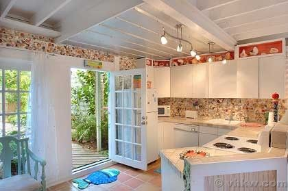 Carriage Cottage (Sea Shell Cottage) in Key West. This looks adorable... the entire kitchen walls are covered with shells!!! This looks adorable, but sadly it doesn't have good reviews :(