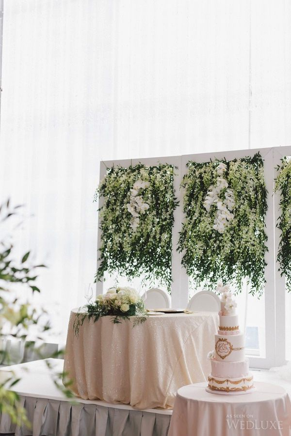 Lush floral background to tie the romantic atmosphere together | Photography by: Purple Tree Photography | Wedluxe Magazine | #luxury #wedding #floral #backdrop #weddinginspiration