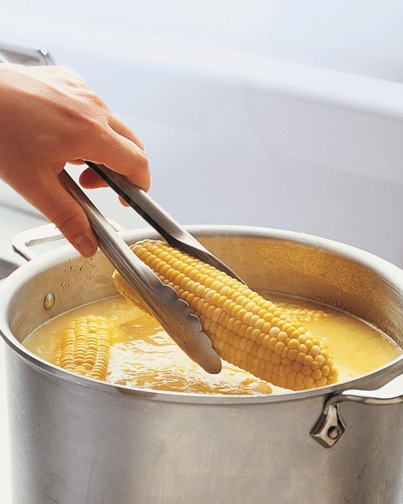 Serve corn on the cob already buttered so guests can dig right in. Bring water to a boil in a stockpot (don't add any salt; it toughens kernels), and drop in 6 to 8 ears. Return to a boil, then cook 2 to 4 minutes for crisp-tender corn. When ears are just about done, slice 8 tablespoons of unsalted butter, and drop them into the cooking water; stir to melt. The butter will float, and each ear will get an even coating as you remove it from the pot with tongs.