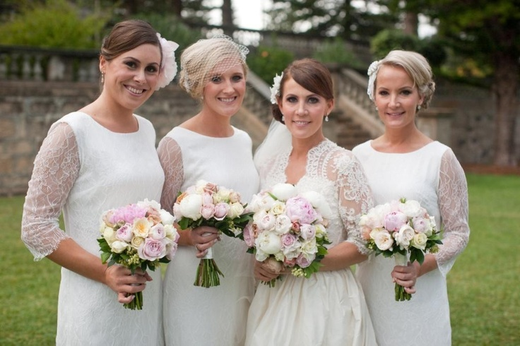 Beautiful bride and bridesmaids with gorgeous bouquets by www.poppysflowers.com.au