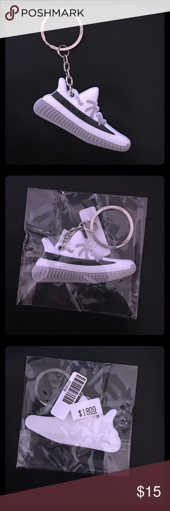 Adidas Yeezy Boost 350 Keychain Mini silicone Adidas Yeezy Boost 350 V2 Keychain. Color way: white/ charcoal/ lt. gray. New in package. 😎 Accessories Key & Card Holders