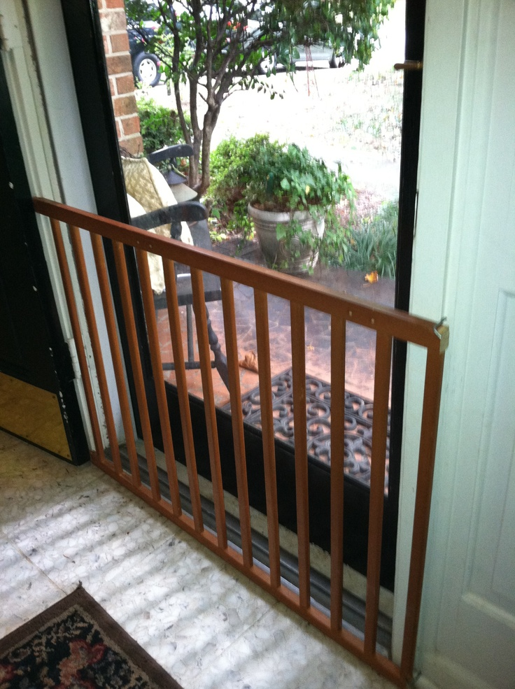 Old Crib Rail Repurposed As A Baby Gate For The Front Door