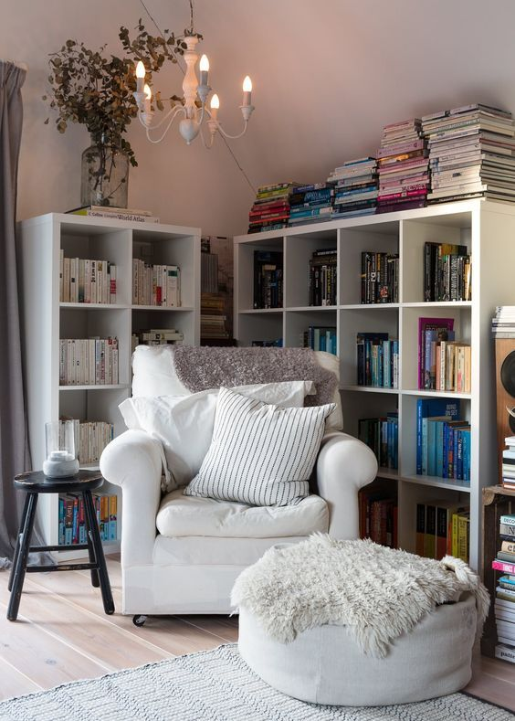 A cozy reading nook in the corner of a loft. This reading nook is such a dream! Airy, modern, but romantic.