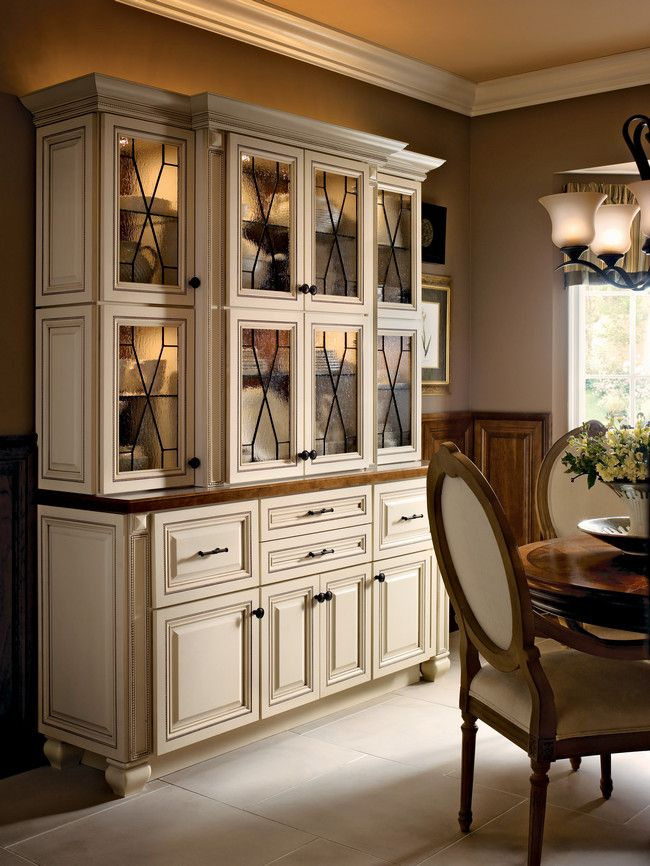 Mullion textured glass and oil rubbed bronze hardware accent this maple hutch in canvas with - Dining room showcase designs ...