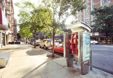 Architect and photographer John Locke took the free library concept to a more urban level. He turned old, unused pay phones in New York City into small lending libraries. SO cool.