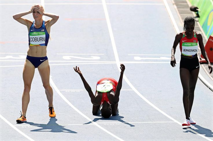 Ruth Jebet (center) of Bahrain reacts after winning the gold medal in the women's 3000m steeplechase final of the Rio 2016 Olympic Games Athletics, Track and Field events at the Olympic Stadium. Jebet won ahead of second placed Hyvin Kiyeng Jepkemoi (right) of Kenya and third placed Emma Coburn of the United States