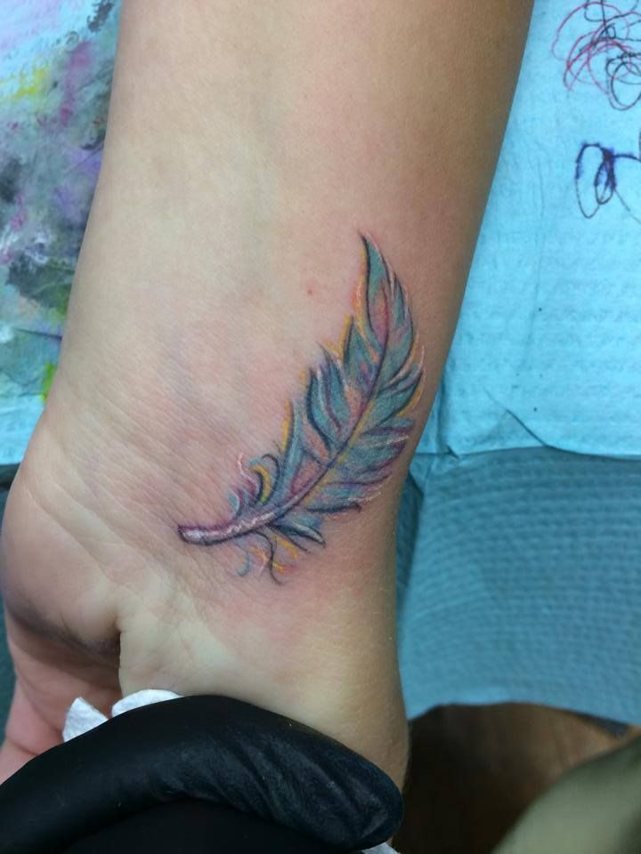 Coverup by Jared.  South Vineland's Firehouse tattoo.  underneath the feather is a double heart....